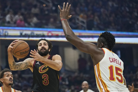 Cleveland Cavaliers' Ricky Rubio (3) drives to the basket against Atlanta Hawks' Clint Capela (15) in the first half of an NBA basketball game, Saturday, Oct. 23, 2021, in Cleveland. (AP Photo/Tony Dejak) Ricky Rubio,Clint Capela