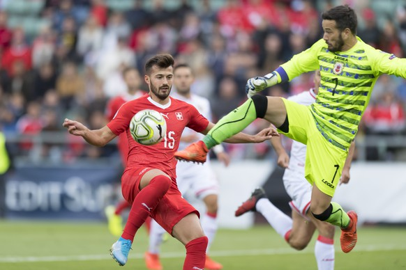 Switzerland's forward Albian Ajeti, left, fights for the ball with Gibraltar's goalkeeper Kyle Goldwin, right, during the UEFA Euro 2020 qualifying Group D soccer match between the Switzerland and Gibraltar, at the Tourbillon Stadium in Sion, Switzerland, Sunday, September 8, 2019. (KEYSTONE/Laurent Gillieron)