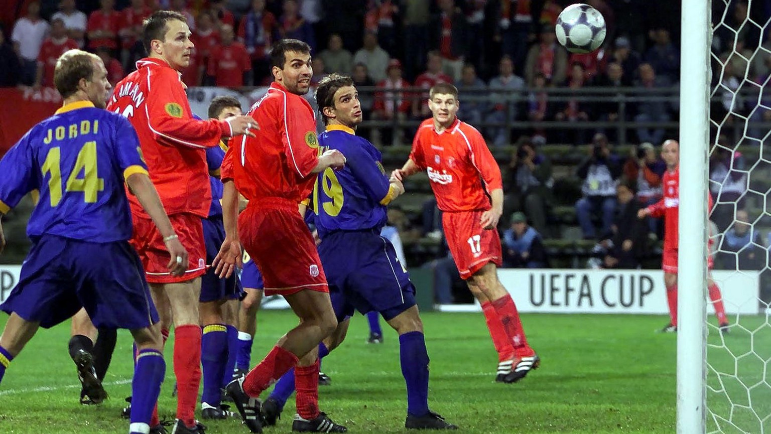 Players watch the ball go into the net, an own goal by Delfi Geli,  to give  Liverpool a 5-4  victory against Deportivo Alaves, Spain, during the UEFA Cup final in Dortmund, Germany, on Wednesday, May 16, 2001. (AP Photo/David Davies)UNITED KINGDOM OUT, , NO MAGS