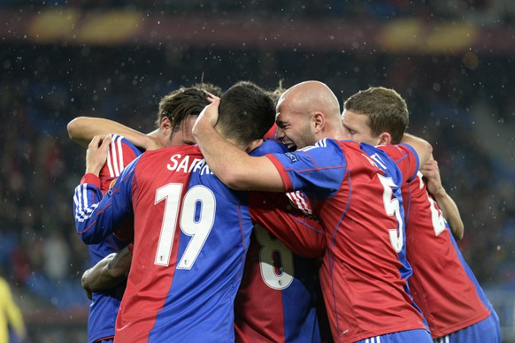 FC Basel's players cheer after their second goal during the UEFA Europa League round of 32 second leg soccer match between Switzerland's FC Basel 1893 and Israel's Maccabi Tel Aviv FC at the St. Jakob-Park stadium in Basel, Switzerland, on Thursday, February 27, 2014. (KEYSTONE/Georgios Kefalas)