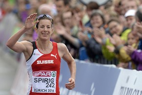 Nicola Spirig from Switzerland crosses the finish line in the women's Marathon in the city centre of Zurich at the fifth day of the European Athletics Championships in Zurich, Switzerland, Saturday, August 16, 2014. (KEYSTONE/Steffen Schmidt)