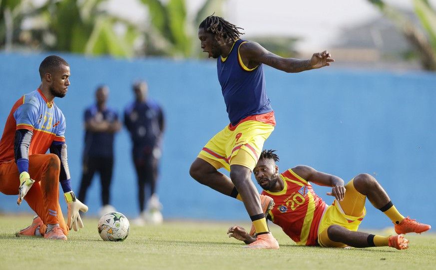 Congo's Joel Kiassumbua, left, Dieumerci Mbokani, centre, and Jacques Maghoma attend a training session at the Stade Akoakam, Oyem Gabon, Tuesday, Jan. 17, 2017, ahead of their African Cup of Nations Group C soccer match against Ivory Coast. (AP Photo/Sunday Alamba)