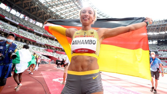 epa09389267 Malaika Mihambo of Germany reacts after winning the Gold Medal in the Women
