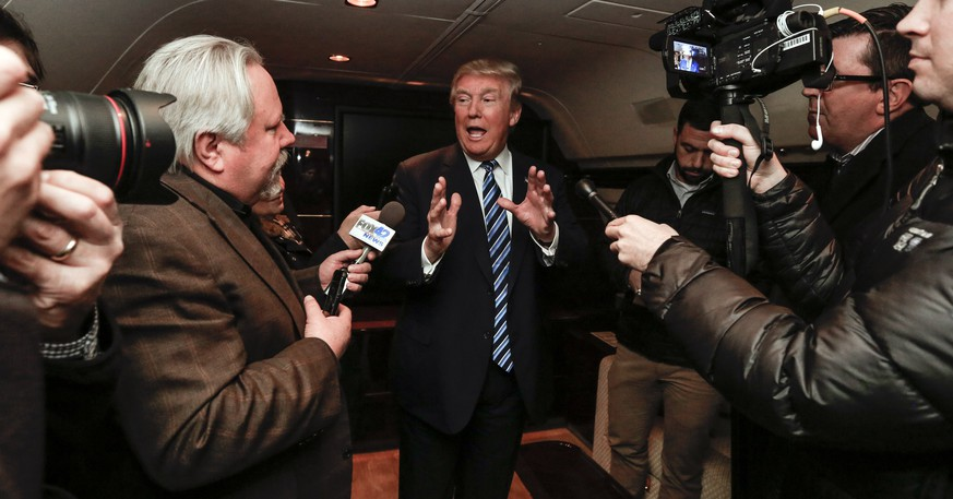 Republican presidential candidate Donald Trump speaks during a news conference on his airplane in Omaha, Neb., Tuesday, Dec. 29, 2015. (AP Photo/Nati Harnik)