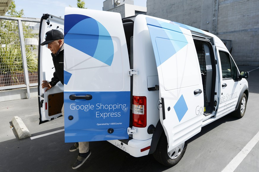 LOS ANGELES, CA - MAY 5: A Google Shopping Express van is seen at Google headquarters on May 5, 2014, in Los Angeles, California. The same day delivery program, which started in San Francisco, is expanding to West Los Angeles and Manhattan and will offer free unlimited delivery for the first six months for new sign ups.   Kevork Djansezian/Getty Images/AFP == FOR NEWSPAPERS, INTERNET, TELCOS & TELEVISION USE ONLY ==