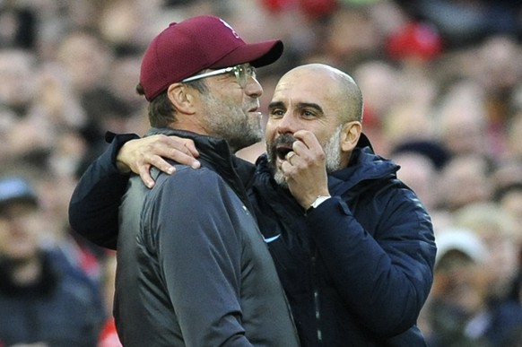 Manchester City manager Josep Guardiola, right, and Liverpool manager Juergen Klopp talk during the English Premier League soccer match between Liverpool and Manchester City at Anfield stadium in Liverpool, England, Sunday, Oct. 7, 2018. (AP Photo/Rui Vieira)