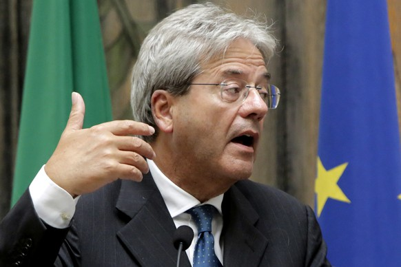 Italy's Foreign Minister Paolo Gentiloni talks to the media during a press conference after a meeting with his Cyprus' counterpart Ioannis Kasoulides at the foreign house in capital Nicosia, Cyprus, Monday, Sept. 12, 2016. Gentiloni is in Cyprus for talks in one-day official visit. (AP Photo/Petros Karadjias)