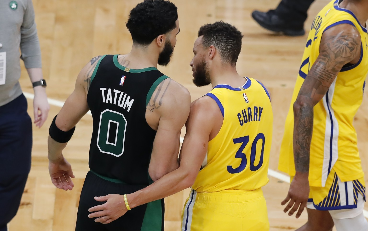 Boston Celtics' Jayson Tatum (0) and Golden State Warriors' Stephen Curry (30) talk following an NBA basketball game, Saturday, April 17, 2021, in Boston. (AP Photo/Michael Dwyer) Jayson Tatum,Stephen Curry