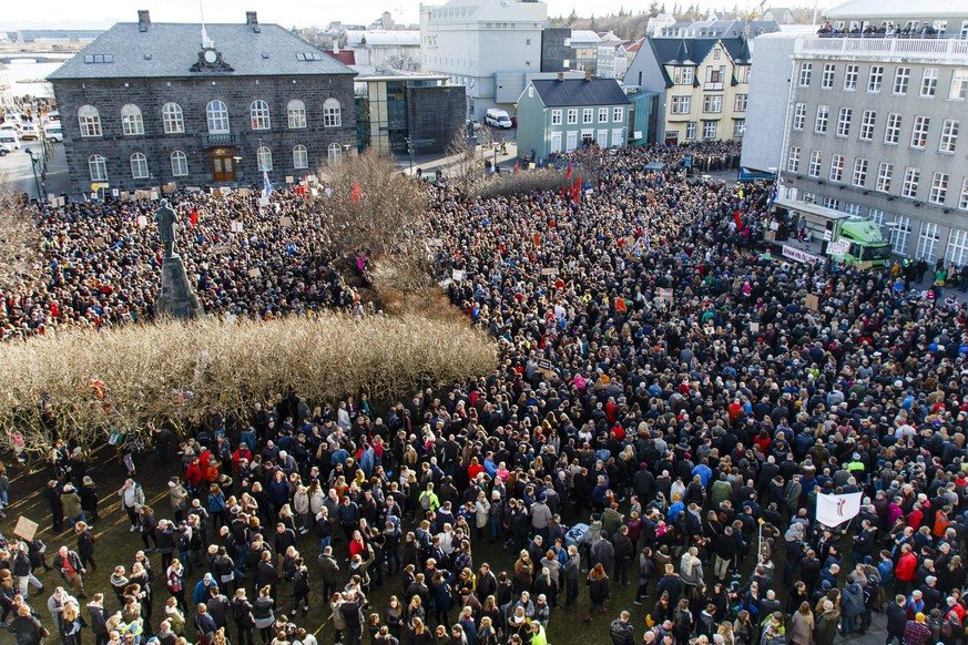epaselect epa05244063 People gather during a protest on Austurvollur Square in front of the Icelandic Parliament in Reykjavic, Iceland, 04 April 2016, calling for the resignation of Prime Minister Sigmundur David Gunnlaugson. Gunnlaugson is one of the allegedly involved as millions of leaked documents published on 03 April 2016 suggest that 140 politicians and officials from around the globe, including 72 former and current world leaders, have connections with secret 'offshore' companies to escape tax scrutiny in their countries. The leak involves 11.5 million documents from one of the world's largest offshore law firms, Mossack Fonseca, based in Panama. The investigation dubbed 'The Panama Papers' was undertaken and headed by German newspaper Sueddeutsche Zeitung and Washington-based International Consortium of Investigative Journalists (ICIJ), with the collaboration of reporters from more than 100 media outlets in 78 countries around the world.  EPA/BIRGIR POR HARDARSON ICELAND OUT