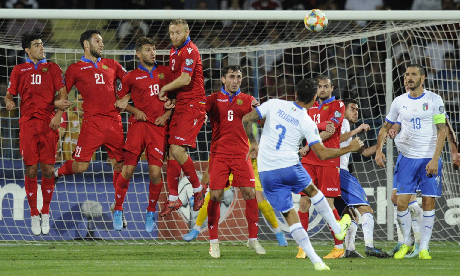 Italy's Lorenzo Pellegrini, front, scores a goal during the Euro 2020 group J qualifying soccer match between Armenia and Italy at the Vazgen Sargsyan Republican stadium in Yerevan, Armenia, Thursday, Sept. 5, 2019. (AP Photo/Hakob Berberyan)
