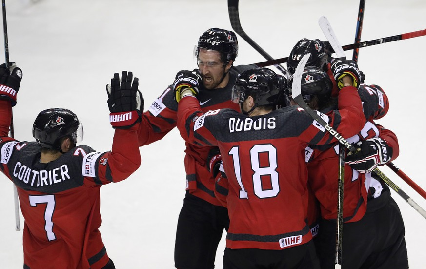 Canada players celebrate after scoring their second goal during the Ice Hockey World Championships quarterfinal match between Canada and Switzerland at the Steel Arena in Kosice, Slovakia, Thursday, May 23, 2019. (AP Photo/Petr David Josek)