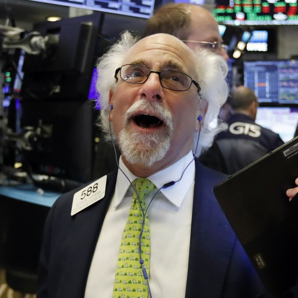 Trader Peter Tuchman works on the floor of the New York Stock Exchange, Wednesday, May 1, 2019. Stocks are opening higher on Wall Street after several big U.S. companies reported earnings that were better than analysts were expecting. (AP Photo/Richard Drew)