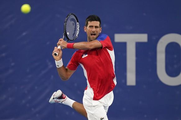 Novak Djokovic, of Serbia, plays Kei Nishikori, of Japan, during the quarterfinals of the tennis competition at the 2020 Summer Olympics, Thursday, July 29, 2021, in Tokyo, Japan. (AP Photo/Seth Wenig) Novak Djokovic