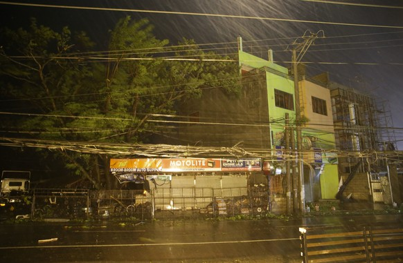 Strong winds and rain batter a town as Typhoon Mangkhut hits Tuguegarao city, Cagayan province, northeastern Philippines on Saturday, Sept. 15, 2018. Typhoon Mangkhut slammed into the country's northeastern coast early Saturday, with witnesses saying the storm's ferocious wind and blinding rain ripped off tin roof sheets and knocked out power at the start of the onslaught. (AP Photo/Aaron Favila)