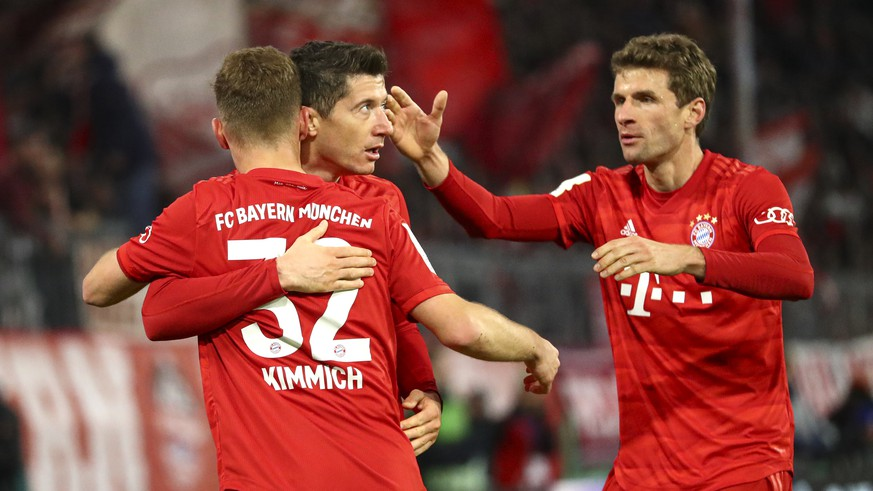 Bayern's Robert Lewandowski celebrates after scoring his side's fourth goal during the German soccer cup, DFB Pokal, match between FC Bayern Munich and TSG Hoffenheim in Munich, Germany, Wednesday, Feb. 5, 2020. (AP Photo/Matthias Schrader)