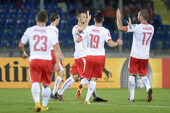 Switzerland's players cheer after scoring during the UEFA EURO 2016 group E qualifying soccer match between San Marino and Switzerland at the San Marino Stadium in San Marino, on Tuesday, October 14, 2014. (KEYSTONE/Georgios Kefalas)