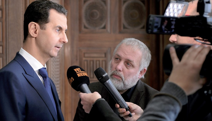 epa05775847 A handout photo made available by the official Syrian Arab News Agency (SANA) on 07 February 2017 shows Syrian President Bashar al-Assad (L) speaking to Belgian media in Damascus, Syria, 06 February 2017. According to SANA, Assad said statements by the US administration on prioritizing the fight against terrorism are 'promising', adding it was still early to expect anything practical.  EPA/SANA HANDOUT  HANDOUT EDITORIAL USE ONLY/NO SALES