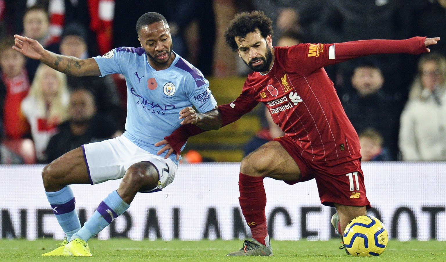 epa07986506 Mohamed Salah (R) of Liverpool in action against Raheem Sterling (L) of Manchester City during the English Premier League soccer match between Liverpool FC and Manchester City in Liverpool, Britain, 10 November 2019.  EPA/PETER POWELL EDITORIAL USE ONLY. No use with unauthorized audio, video, data, fixture lists, club/league logos or 'live' services. Online in-match use limited to 120 images, no video emulation. No use in betting, games or single club/league/player publications