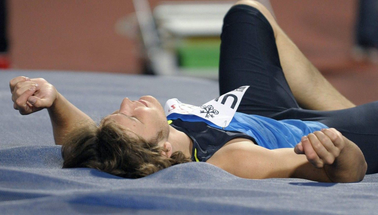Russian Ivan Ukhov lies on his back after aborting a jump during the men's high jump competition at the Athletissima athletics meeting in the Stade Olympique in Lausanne, Switzerland, Tuesday, September 2, 2008. (KEYSTONE/Laurent Gillieron)