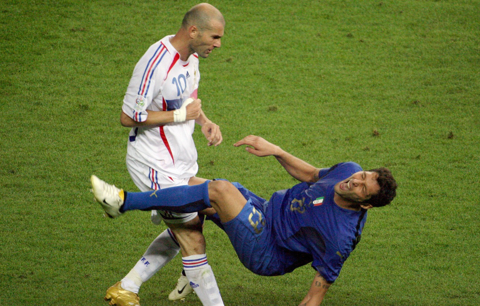 Berlin, GERMANY:  A photo taken 09 July 2006 shows French midfielder Zinedine Zidane (L) gesturing after head-butting Italian defender Marco Materazzi during the World Cup 2006 final football match between Italy and France at Berlin?s Olympic Stadium.  AFP PHOTO  JOHN MACDOUGALL  (Photo credit should read JOHN MACDOUGALL/AFP/Getty Images)