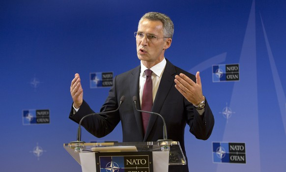 Incoming NATO Secretary General Jens Stoltenberg addresses a first media conference at NATO headquarters in Brussels on Wednesday, Oct. 1, 2014. Former two-term Norwegian Prime Minister Jens Stoltenberg started work Wednesday as NATO's secretary-general, the 13th in the trans-Atlantic organization's 65-year existence. (AP Photo/Virginia Mayo)
