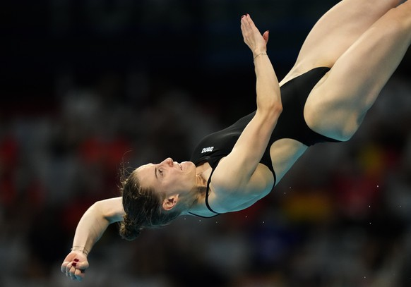 Michelle Heimberg of Switzerland competes in women's diving 3m springboard final at the Tokyo Aquatics Centre at the 2020 Summer Olympics, Sunday, Aug. 1, 2021, in Tokyo, Japan. (AP Photo/Dmitri Lovetsky)