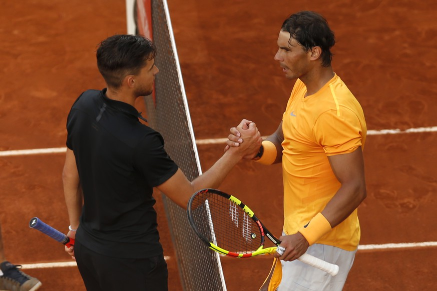 Dominic Thiem from Austria, left, shakes hands with Rafael Nadal from Spain at the end of a Madrid Open tennis tournament match in Madrid, Spain, Friday, May 11, 2018. Thiem won 7-5, 6-3. (AP Photo/Francisco Seco)