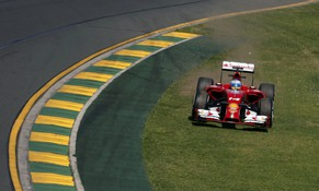 Ferrari Formula One driver Fernando Alonso of Spain drives on the grass during the first practice session of the Australian F1 Grand Prix at the Albert Park circuit in Melbourne March 14, 2014. REUTERS/David Gray (AUSTRALIA  - Tags: SPORT MOTORSPORT F1 TPX IMAGES OF THE DAY)