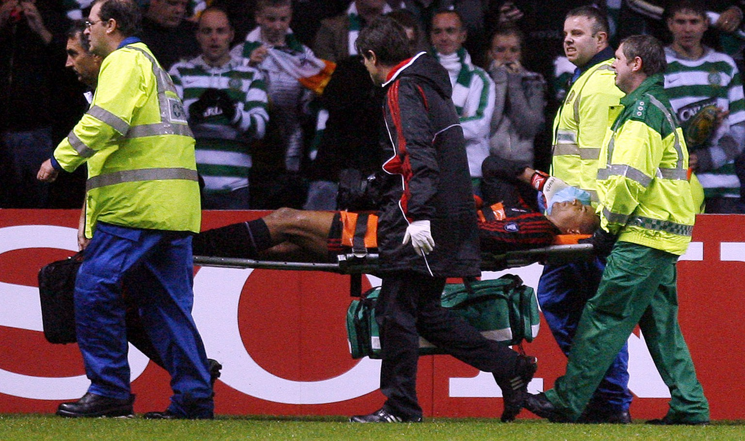 AC Milan's goalkeeper Dida is carried off after an incident with  a Celtic fan during their Champions League, Group D, soccer match at Celtic Park, Glasgow, Scotland, Wednesday Oct. 3, 2007. (AP Photo/Scott Heppell)
