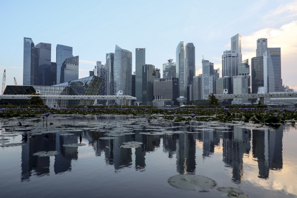 epa06788677 The skyline of Singapore's financial district is reflected in a lotus pond at the ArtScience Museum in Singapore, 06 June 2018. The White House has confirmed that US President Donald J. Trump and North Korean leader Kim Jong-un will meet at the Capella Hotel on Singapore's Sentosa Island for their expected historic summit on 12 June 2018.  EPA/WALLACE WOON
