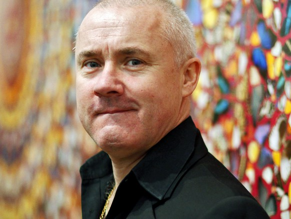 epa04778362 (FILE) The file picture dated 02 April 2012 shows British artist Damien Hirst posing in front of his painting 'I Am Become Death, Shatterer of Worlds' at the retrospective exhibition held at the Tate Modern museum in London, Britain. Damien Hirst will turn 50 on 07 June 2015.  EPA/KERIM OKTEN      EDITORIAL USE ONLY  EDITORIAL USE ONLY *** Local Caption *** 51139411