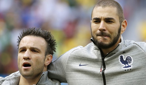 epa05063655 (FILE) File picture dated 30 June 2014 of French players Mathieu Valbuena (L) and Karim Benzema prior to the FIFA World Cup 2014 round of 16 match between France and Nigeria at the Estadio Nacional in Brasilia, Brazil. The French soccer federation announced 10 December 2015 that is suspending Karim Benzema from the national soccer team over a sex tape blackmail case involving team-mate Mathieu Valbuena.   (RESTRICTIONS APPLY: Editorial Use Only, not used in association with any commercial entity - Images must not be used in any form of alert service or push service of any kind including via mobile alert services, downloads to mobile devices or MMS messaging - Images must appear as still images and must not emulate match action video footage - No alteration is made to, and no text or image is superimposed over, any published image which: (a) intentionally obscures or removes a sponsor identification image; or (b) adds or overlays the commercial identification of any third party which is not officially associated with the FIFA World Cup)  EPA/JORGE ZAPATA   EDITORIAL USE ONLY