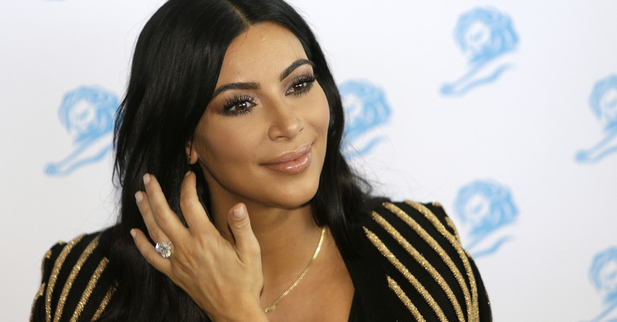 FILE - In this June 24, 2015 file photo, American television personality Kim Kardashian poses for photographers as she attends the Cannes Lions 2015 in Cannes, southern France. The Food and Drug Administration says Kardashian's social media posts promoting Diclegis, an prescription anti-morning sickness drug, violate federal drug promotion rules because they don't mention potentially dangerous side effects and drug interactions.. (AP Photo/Lionel Cironneau, File)