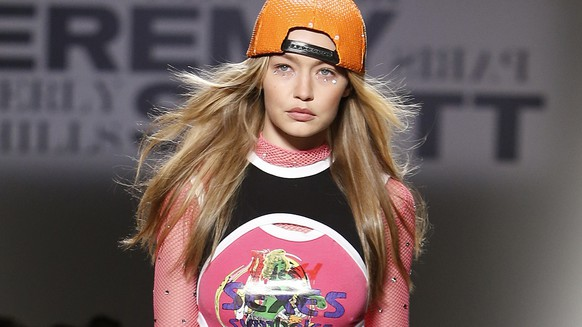 FILE - In this Friday, Sept. 8, 2017, file photo, Gigi Hadid models fashion from the Jeremy Scott spring 2018 collection during Fashion Week in New York.  Hadid says she will not be walking the Victoria's Secret fashion show in Shanghai next week. In a post on her Twitter account Friday, Hadid did not explain why she would be missing the show and Victoria's Secret refused to comment on the issue. (AP Photo/Jason DeCrow, File)