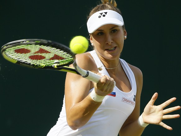 Belinda Bencic of Switzerland returns a shot of Anna-Lena Friedsam of Germany, during their singles match at the All England Lawn Tennis Championships in Wimbledon, London, Wednesday July 1, 2015. (AP Photo/Kirsty Wigglesworth)