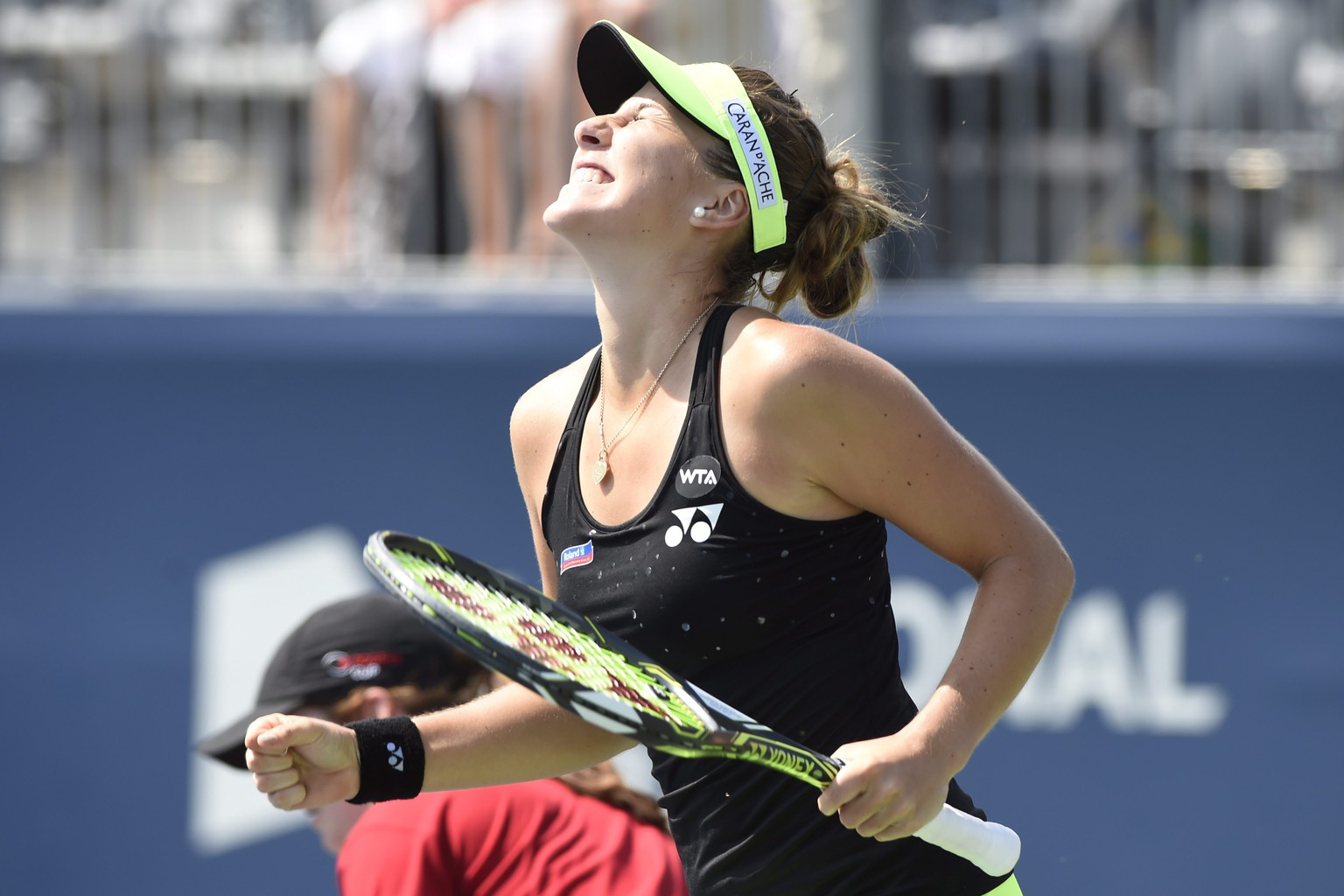 Belinda Bencic, of Switzerland, celebrates her win over Sabine Lisicki, of Germany, in the Rogers Cup women's tennis tournament in Toronto, Thursday, Aug. 13, 2015. (Frank Gunn/The Canadian Press via AP) MANDATORY CREDIT