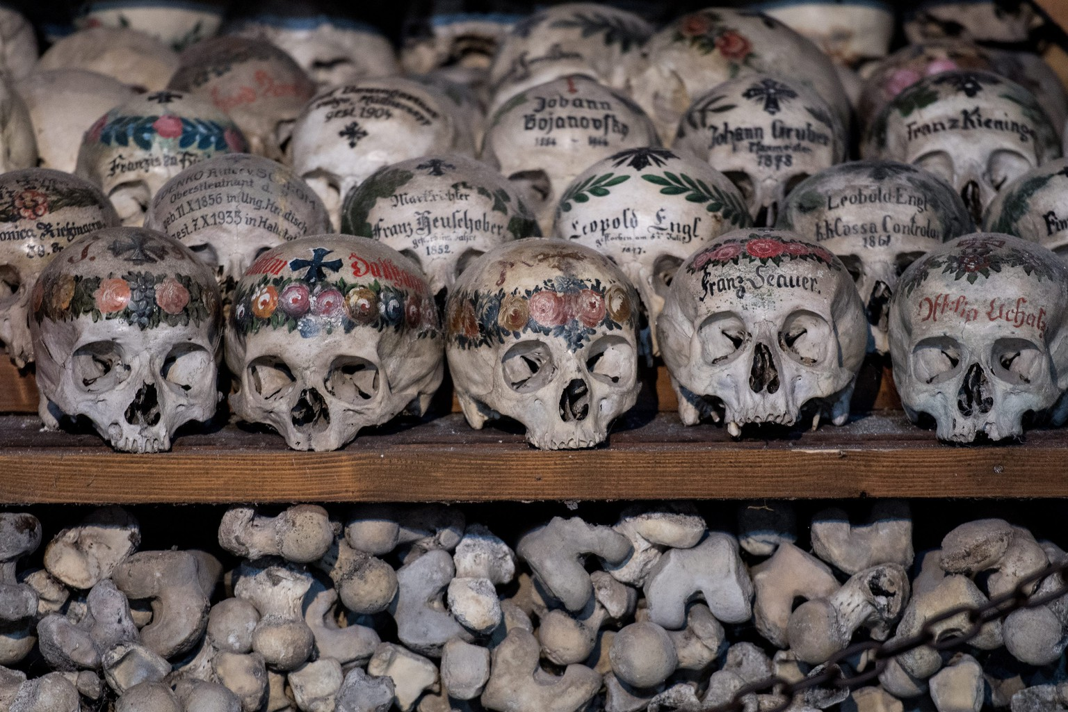 epa05574823 Human skulls and bones at the Bone House (Beinhaus) in the Austrian UNESCO world heritage village of Hallstatt, some 300 kilometers southwest of Vienna, Austria, 07 October 2016. The Bone House comprises up to 1,200 skulls. In 2012, Hallstatt was replicated in China's southern city of Huizhou in Guangdong province for a residential project.  EPA/CHRISTIAN BRUNA
