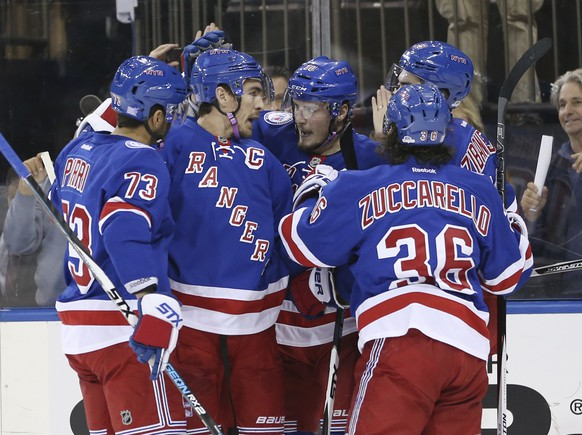 New York Rangers' J.T. Miller, center, celebrates with teammates after scoring during the second period of the NHL hockey game against the Arizona Coyotes, Sunday, Oct. 23, 2016, in New York. (AP Photo/Seth Wenig)