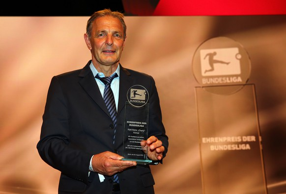 BERLIN, GERMANY - AUGUST 06: Karl Heinz Koerbel is awarded with the prize of the Bundesliga during the 50 Years of Bundesliga Gala at Estrel Hotel on August 6, 2013 in Berlin, Germany.  (Photo by Martin Rose/Bongarts/Getty Images)