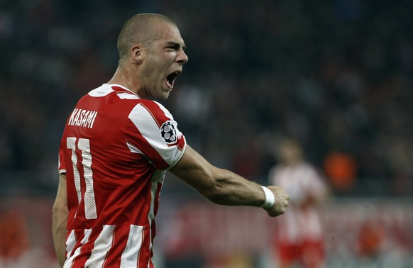 Olympiakos' Pajtim Kasami celebrates his side's opening goal during the Champions League Group A soccer match between Olympiakos and Malmo at Georgios Karaiskakis Stadium in the port of Piraeus near Athens, on Thursday, Dec. 9, 2014.(AP Photo/Petros Giannakouris)