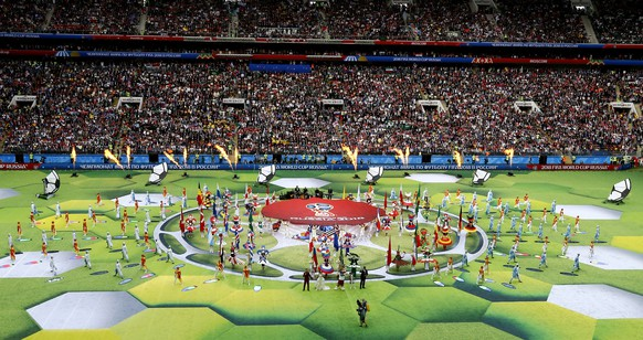 epa06807147 Actors perform during the opening ceremony prior to the FIFA World Cup 2018 group A preliminary round soccer match between Russia and Saudi Arabia in Moscow, Russia, 14 June 2018.(RESTRICTIONS APPLY: Editorial Use Only, not used in association with any commercial entity - Images must not be used in any form of alert service or push service of any kind including via mobile alert services, downloads to mobile devices or MMS messaging - Images must appear as still images and must not emulate match action video footage - No alteration is made to, and no text or image is superimposed over, any published image which: (a) intentionally obscures or removes a sponsor identification image; or (b) adds or overlays the commercial identification of any third party which is not officially associated with the FIFA World Cup)  EPA/ABEDIN TERKENAREH   EDITORIAL USE ONLY