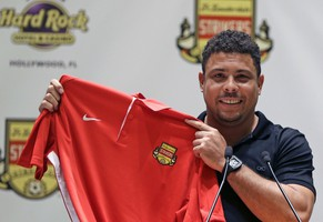 Three-time FIFA player of the year Ronaldo Luís Nazário de Lima poses for photographers with a Fort Lauderdale Strikers jersey after talking about his new role as part owner of the Fort Lauderdale Strikers  during a news conference Wednesday, Jan. 14, 2015, in Hollywood, Fla. Ronaldo says he will attempt to make a playing comeback this spring with the Fort Lauderdale Strikers of the second-tier North American Soccer League.(AP Photo/Alan Diaz)