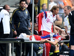 DORTMUND, GERMANY - AUGUST 13:  The injured Javi Martinez of Munich is stretchered off the pitch during the DFL Supercup between Borrussia Dortmund and FC Bayern Muenchen at Signal Iduna Park on August 13, 2014 in Dortmund, Germany.  (Photo by Lars Baron/Bongarts/Getty Images)