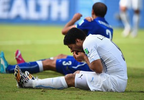 FILE: Uruguay striker Luis Suarez has been suspended for four months, for biting Italy defender Giorgio Chiellini. NATAL, BRAZIL - JUNE 24:  Luis Suarez of Uruguay and Giorgio Chiellini of Italy react after a clash during the 2014 FIFA World Cup Brazil Group D match between Italy and Uruguay at Estadio das Dunas on June 24, 2014 in Natal, Brazil.  (Photo by Matthias Hangst/Getty Images)