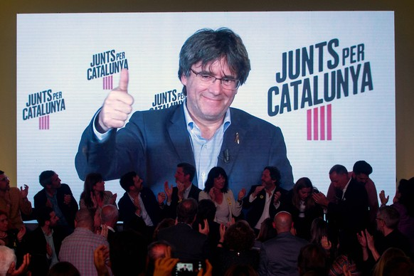 epa07559915 Catalan former regional President and JxCat candidate for the European Parliament, Carles Puigdemont, is seen on a big screen during an event held on occasion of the start of the campaign for the European, local and regional elections in Barcelona, Spain, 09 May 2019 (issued 10 May 2019).  EPA/Quique Garcia