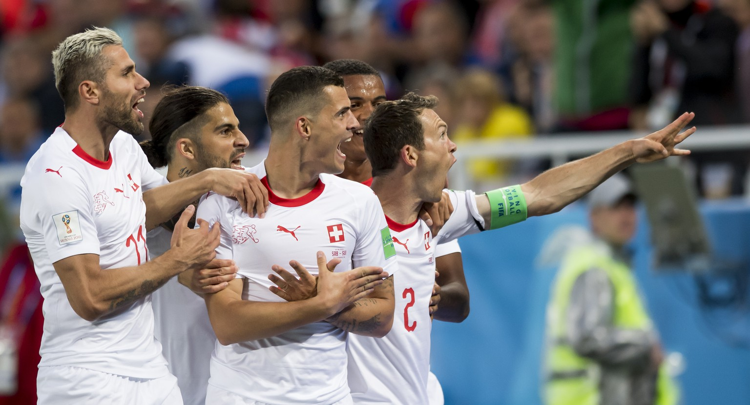 Switzerland's midfielder Granit Xhaka, center, celebrates after scoring a goal with team mates Switzerland's midfielder Valon Behrami, Switzerland's defender Ricardo Rodriguez, Switzerland's defender Manuel Akanji, and Switzerland's defender Stephan Lichtsteiner, from left to right, during the FIFA World Cup 2018 group E preliminary round soccer match between Switzerland and Serbia at the Arena Baltika Stadium, in Kaliningrad, Russia, Friday, June 22, 2018. (KEYSTONE/Laurent Gillieron)