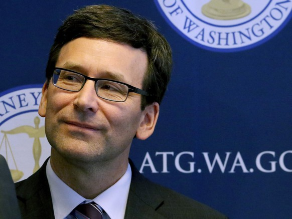 Washington State Attorney Gen. Bob Ferguson looks pleased with the state Supreme Court's unanimous decision in the case against Arlene's Flowers Thursday, Feb. 16, 2017, in Seattle. He argued the case before the court. A lower court had fined Barronelle Stutzman, a florist in Richland, Washington, for denying service to a gay couple in 2013, and ordered her to pay a $1,000 fine.  (Alan Berner/The Seattle Times via AP)