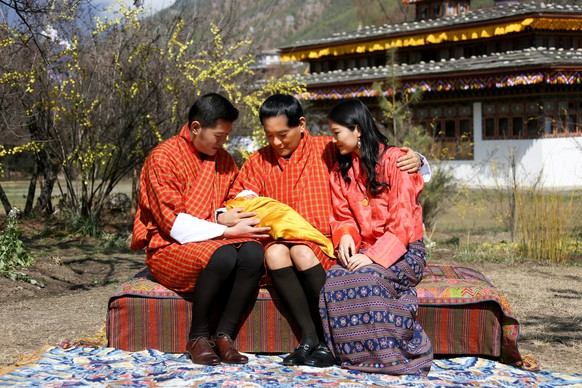 In this Tuesday, Feb. 9, 2016 photo released by the Royal Office for Media of the Kingdom of Bhutan, Bhutanese King Jigme Khesar Namgyel Wangchuck, left, his father and the fourth King of Bhutan Jigme Singye Wangchuck, center, and Queen Jetsun Pema pose with the royal couple's newly born son, Crown Prince Gyalsey, on Losar, the Bhutanese new year based on the Lunar calendar, celebrated this year on Tuesday, at the Lingkana Palace in Thimphu, Bhutan. The Royal Media Office announced the baby boy was born Friday, Feb. 5 to the royal couple. (The Royal Office for Media of the Kingdom of Bhutan via AP) NO SALES, MANDATORY CREDIT