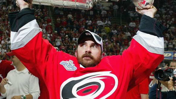 RALEIGH, NC - JUNE 19: Martin Gerber #29 of the Carolina Hurricanes celebrates with the Stanley Cup after defeating the Edmonton Oilers in game seven of the 2006 NHL Stanley Cup Finals on June 19, 2006 at the RBC Center in Raleigh, North Carolina. The Hurricanes defeated the Oilers 3-1 to win the Stanley Cup finals 4 games to 3.(Photo by Jim McIsaac/Getty Images)