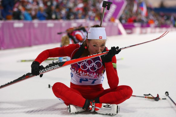 SOCHI, RUSSIA - FEBRUARY 14:  Selina Gasparin of Switzerland kisses her ski at the finish line in the Women's 15 km Individual during day seven of the Sochi 2014 Winter Olympics at Laura Cross-country Ski & Biathlon Center on February 14, 2014 in Sochi, Russia.  (Photo by Paul Gilham/Getty Images)